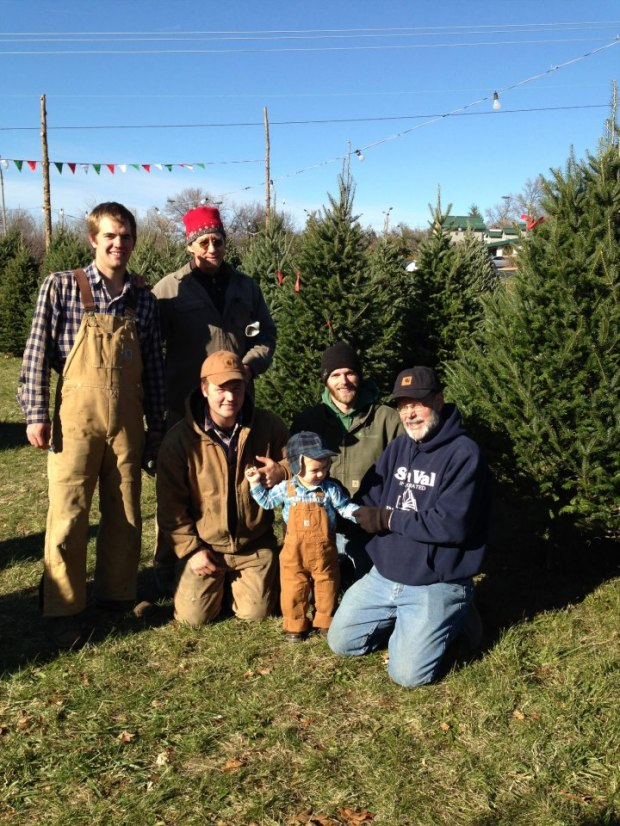 At the Home Grown Trees Christmas tree lot. Matt and his brothers and dad, Benny, from Michigan, and the short one's our nephew.